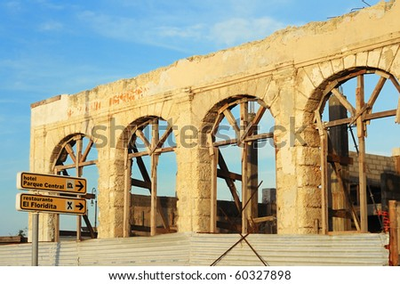 Detail of crumbling facade in Havana building under blue sky - stock photo