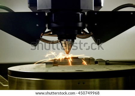 detail of 3d printer printing a metal piece