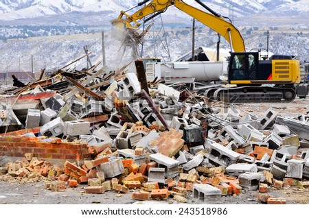Detail of demolition of building collapse bricks wall - stock photo
