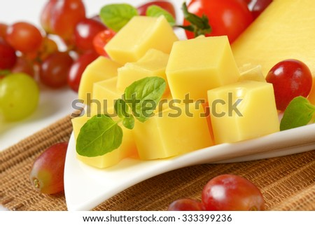detail of diced cheese, basil and red grapes