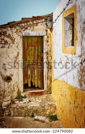 Detail of door and window in an old house ruin - stock photo