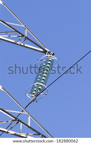 Detail of electric insulators from a medium voltage power pylon. - stock photo