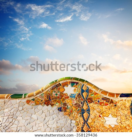 detail of famous colorful bench of park Guell at sunrise, Barcelona, Spain - stock photo