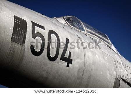 Detail of famous MiG-21 F13 fighter jet plane. Plane with number 504 is first MiG-21 of Yugoslav peoples army ever. - stock photo