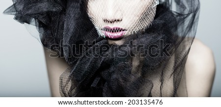 detail of fashion model portrait in studio with lace - stock photo