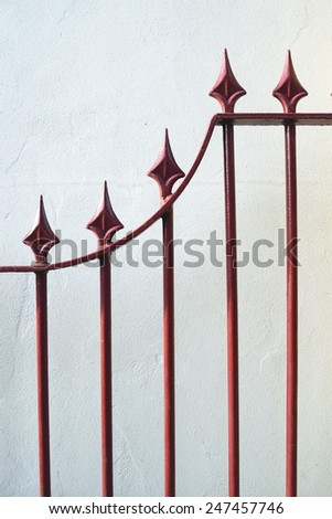 Detail of finely crafted wrought iron style fence - stock photo