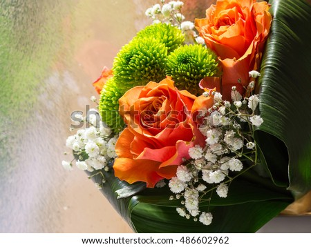 Detail of flower bouquet with orange roses