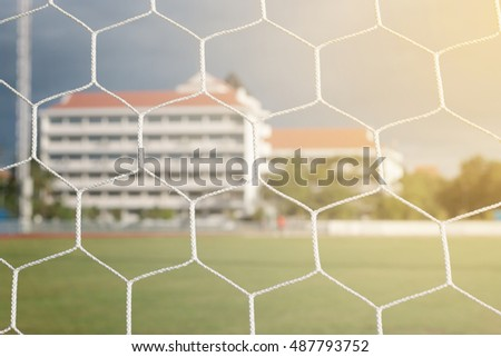 Detail of football net with sunlight in the field background, Football equipment