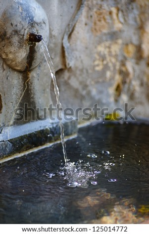 Detail of fountain water built in rock - stock photo