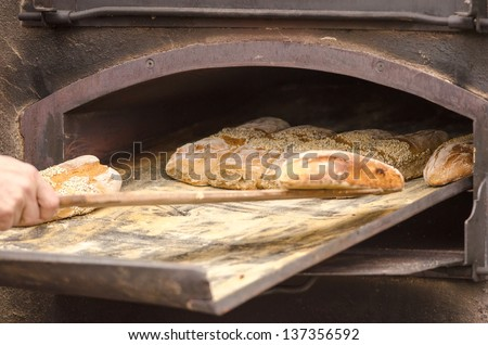 Detail of fresh traditionally baked bread. - stock photo