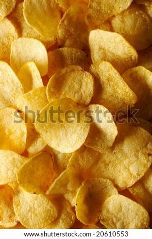 Detail of fried potato chips - stock photo