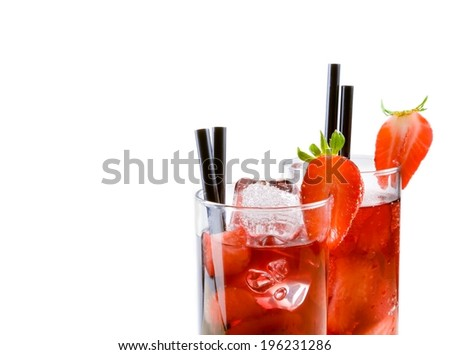 detail of glasses of strawberry cocktail with ice isolated on white background with strawberry on top and space for text - stock photo