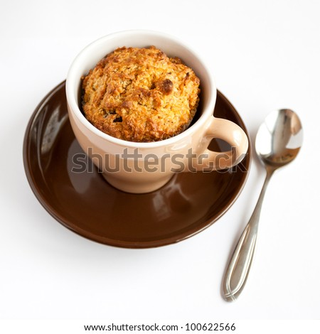 Detail of gluten free muffin in coffee cup on white background - stock photo
