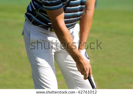 detail of Golfer - stock photo
