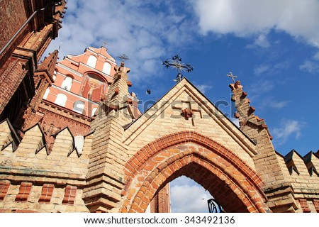 Detail of gothic St. Anne's Church and the Church of St. Francis from Assisi (Historical-architectural ensemble of Bernardines), Vilnius, Lithuania on blue sky background. Selective focus. - stock photo