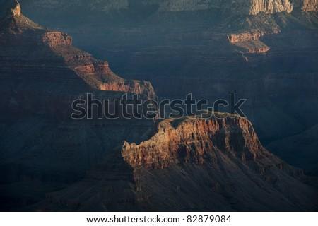 Detail of Grand Canyon mesa in morning shadows - stock photo