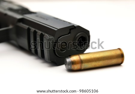 Detail of gun and ammunition, handgun and bullet - stock photo