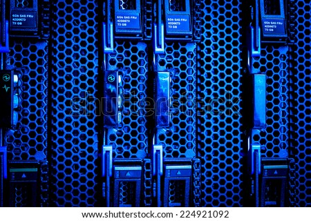 Detail of hard drive cluster in data center - stock photo