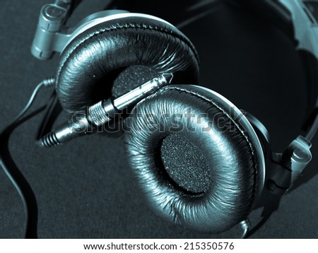 Detail of headphones for music listening and deejaying - selective focus - cool cyanotype - stock photo
