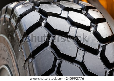 detail of heavy tractor wheel and tire - stock photo