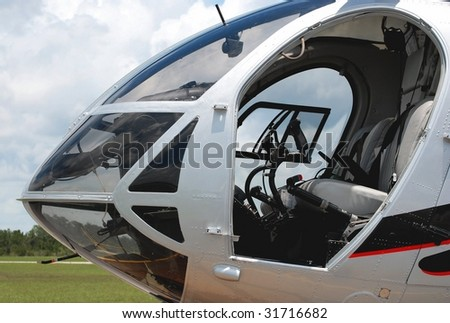 detail of helicopter cockpit - stock photo