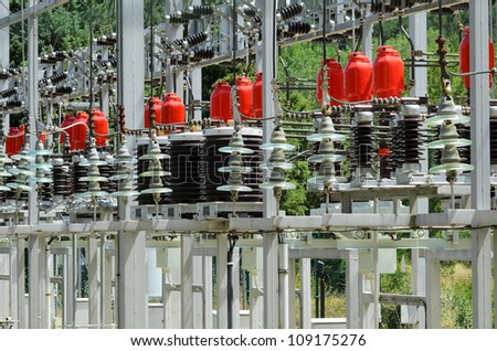 Detail of high voltage transformers in power plant. - stock photo