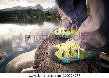 Detail of hiking shoes of hiker, Strbske pleso, High Tatras, Slovakia - stock photo