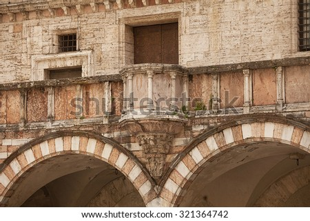 Detail of historic building in the old township of Perugia in the Umbrian region of Italy - stock photo