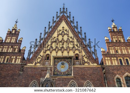 Detail of historic City Hall building in Wroclaw with sundial. Wroclaw old and a very beautiful city in Poland. - stock photo