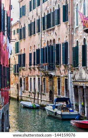 Detail of houses' walls in Venice - stock photo