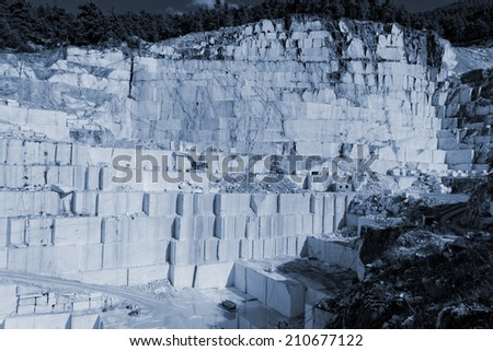 Detail of huge Thassos white marble quarry (mine) with grabber (color filtered photo) abstract - stock photo