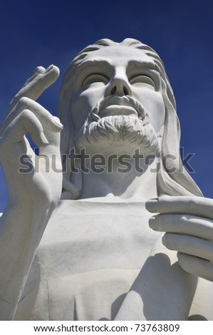 Detail of Jesus Christ statue in Havana against blue sky - stock photo
