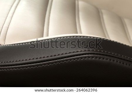 Detail of leather car seat. Horizontal photo. - stock photo