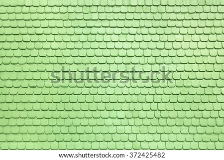 Detail of light green wooden shingles on a facade  - stock photo