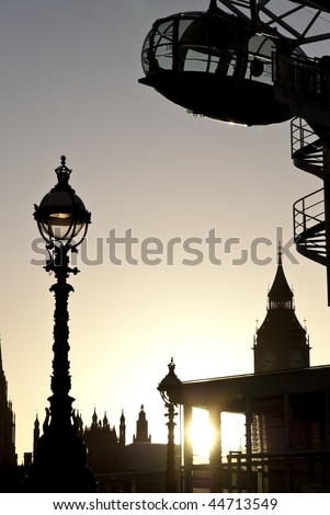 Detail of London Eye seen from Southbank. with Big Ben in the background. - stock photo