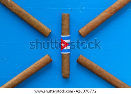 Detail of luxury Cuban cigars on the blue desk - stock photo