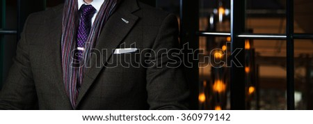 Detail of man in suit - pocketsquare - stock photo