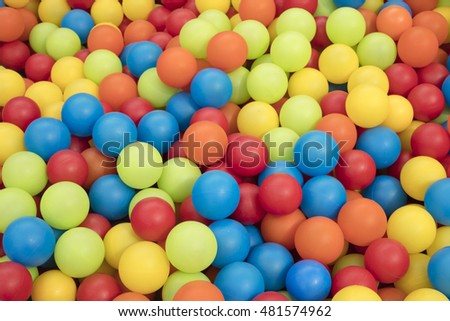 Detail of many colorful plastic balls.