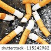 Detail of many dirty cigarettes - stock photo