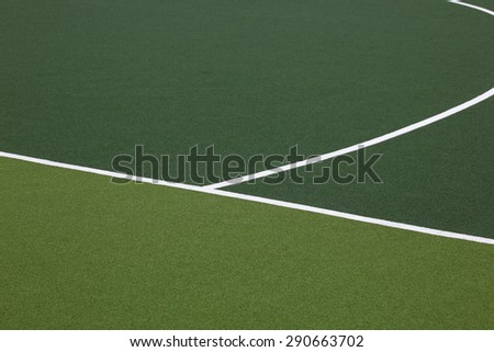 Detail of markings on a synthetic hockey field. - stock photo