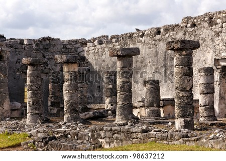 Detail of Mayan ruins with columns at the archeological site in Tulum, Quintana Roo, Mexico. - stock photo