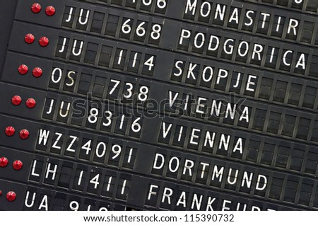 detail of mechanical timetable airport board - stock photo
