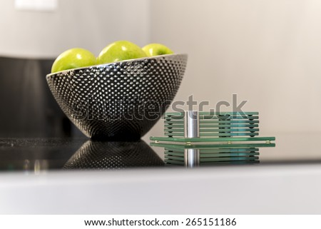 Detail of modern kitchen metal bowl with focus on counter - stock photo