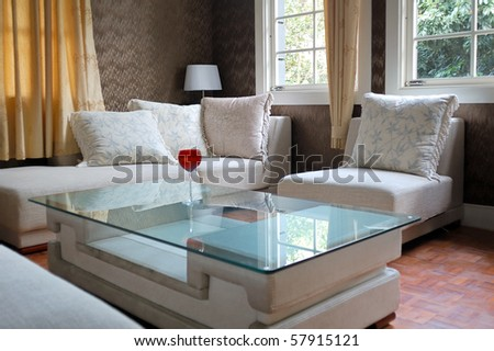 Detail of modern living room with table and sofa