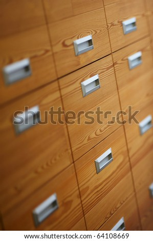 Detail of modern wooden office drawers - stock photo