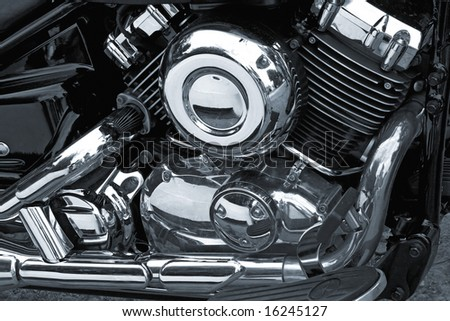 detail of motorcycle engine with chrome covers - stock photo