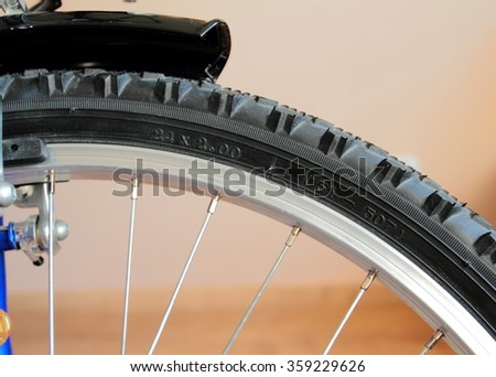 Detail of mountain bike. Bicycle tire with size numbers - stock photo