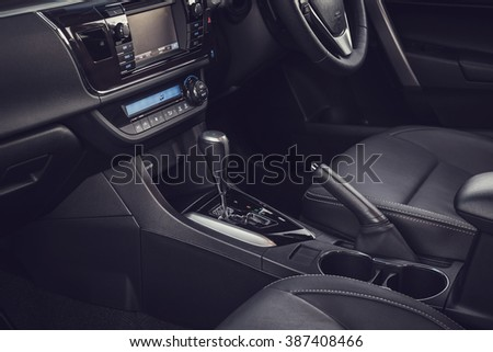 Detail of new modern car interior, Focus on gear (vintage filter effect) - stock photo