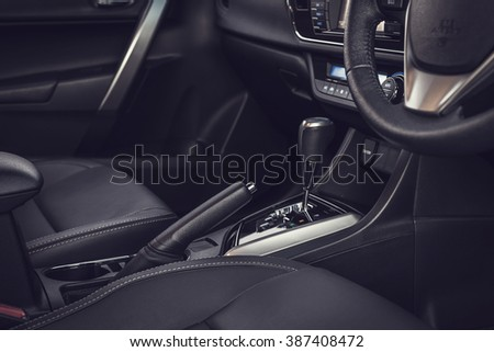Detail of new modern car interior, Focus on hand break (vintage filter effect) - stock photo