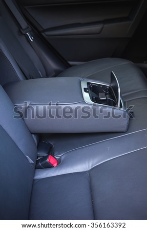 Detail of new modern car interior, Focus on rear seat - stock photo